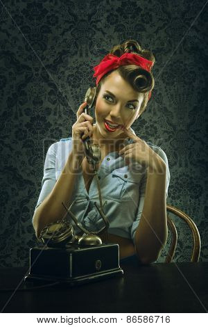 Vintage style - Woman talking on the phone with retro dial phone