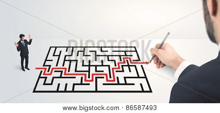 Business man looking at hand drawing solution, maze solution concept