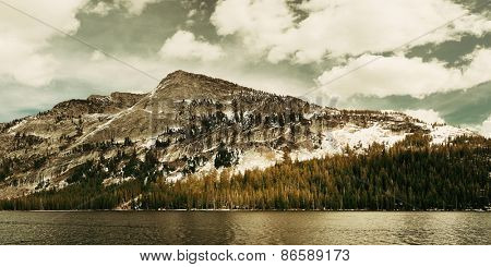 Snow mountain cloud and lake panorama with reflections in Yosemite.