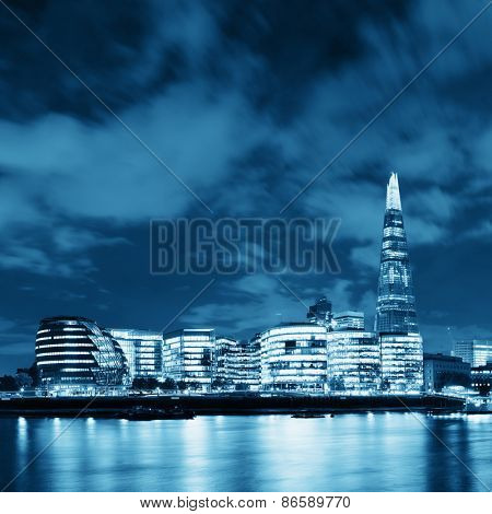 London urban architecture over Thames River at night