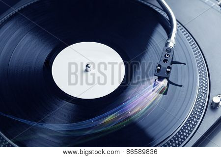 Music player playing vinyl music with colourful abstract lines concept on background