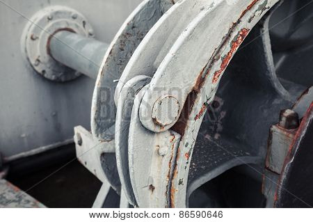 Old Winch Fragment With Big Shaft. Selective Focus