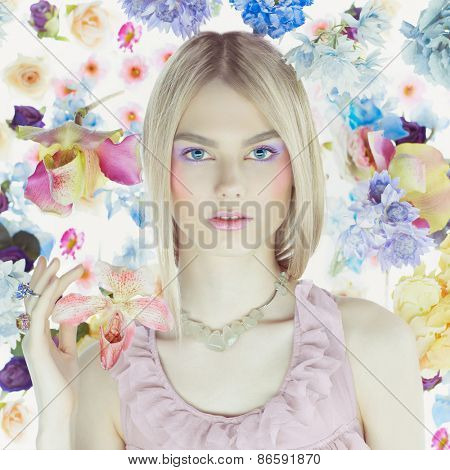 Fashion art portrait of beautiful lady in delicate flowers around
