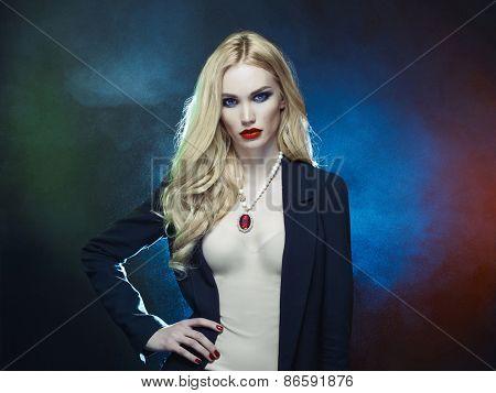 Studio fashion portrait of young beautiful lady on black background