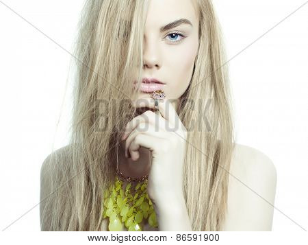Studio fashion portrait of young beautiful lady in jewelry