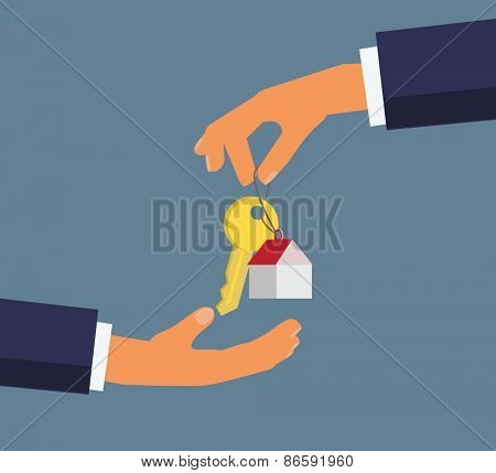 Hand giving key for house,successful investment concept