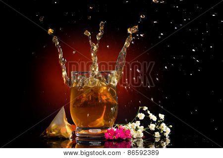 hot tea splashing in the glass