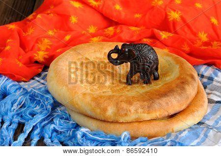 Fatir, Uzbek Flatbread On Blue Arab Scarf And Red Cloth With Elefant Toy Fugure