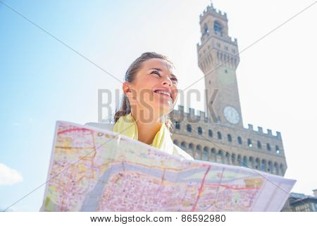 Happy Young Woman With Map In Front Of Palazzo Vecchio In Floren