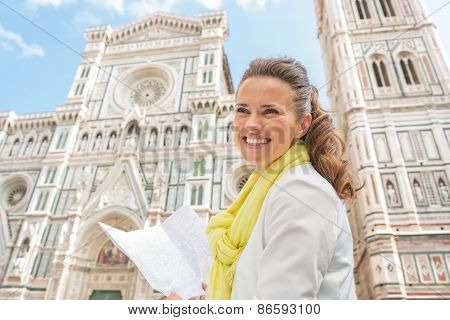 Smiling Young Woman With Map In Front Of Duomo In Florence, Ital