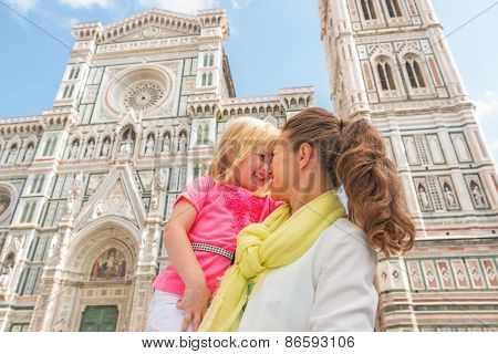 Happy Mother And Baby Girl Hugging In Front Of Duomo In Florence