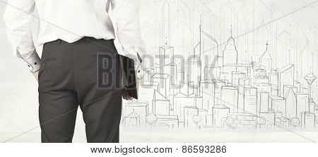Businessman from the back in front of a drawn city view