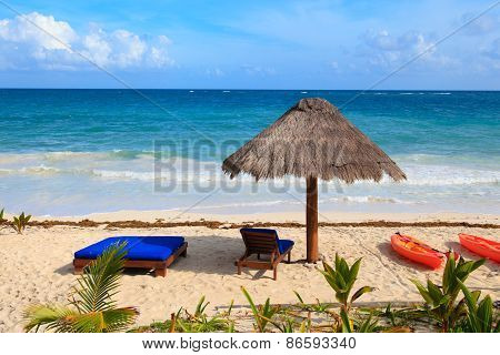 Beach chairs on exotic tropical sand beach