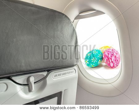 Image Of Easter Egg And  Fasten Seat Belt While Seated Sign On Airplane .