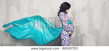 Pregnant woman over gray background