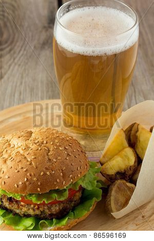 Burger, Roasted Potato Wedges  And Glass Of Beer