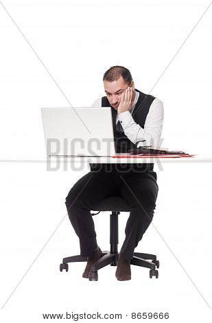 Man with computer and desk