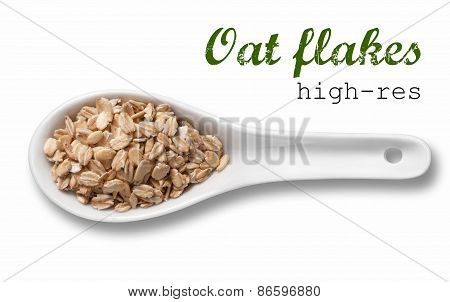 Rolled Oats Flakes In White Porcelain Spoon