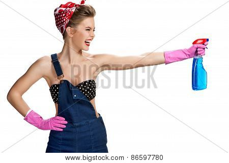 Young Smiling Cleaner Woman Wearing Pink Rubber Protective Gloves Holding Blue Spray Bottle / Young