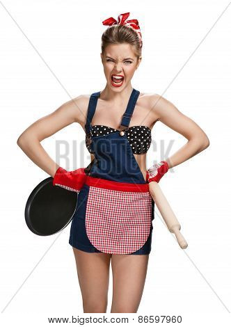 Quarrelsome Maid Wearing Apron With Wooden Rolling Pin And Black Frying Pan / Young Beautiful Americ