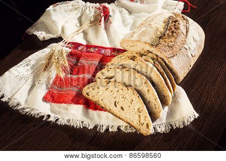 Rustic Bread And Wheat On A Traditional Girl Costume