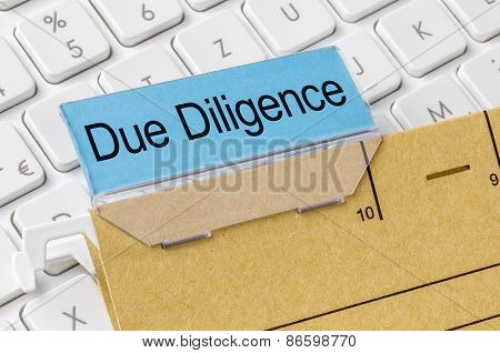 A Brown File Folder Labeled With Due Diligence