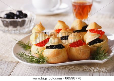 Profiteroles Stuffed With Red And Black Caviar, Horizontal