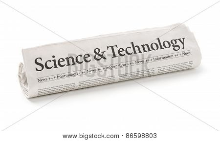 Rolled Newspaper With The Headline Science And Technology