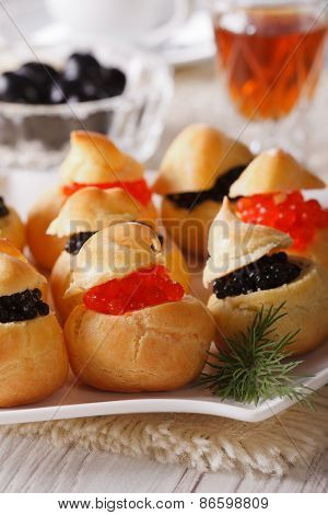 Profiteroles Stuffed With Red And Black Caviar Closeup. Vertical