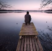 picture of pier a lake  - Small pier on lake with man silhouette - JPG