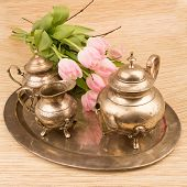 stock photo of pompous  - antik table set with pink tulips on a table - JPG