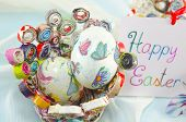 stock photo of decoupage  - Handmade decoupage Easter eggs on a handmade paper plate with a Happy Easter card  - JPG