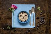 picture of porridge  - Breakfast oatmeal porridge with blueberries flower breakfast - JPG