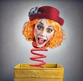 stock photo of clowns  - Strange funny magic box clown with spring - JPG