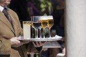 stock photo of catering  - Professional catering service serving drinks to guests - JPG