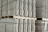 stock photo of piles  - Many concrete blocks piled up on a construction material yard - JPG