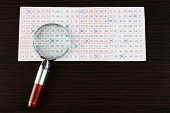 picture of lottery winners  - Analyzing lottery ticket with magnifier - JPG