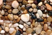 Polished pebbles close up poster