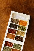 pic of bay leaf  - set of different spices (pepper, salt, turmeric, bay leaves, chili, herbs) in a wooden box - JPG