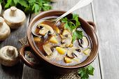 stock photo of champignons  - Mushroom soup with champignons in the bowl on the table - JPG