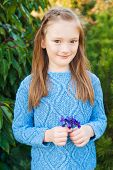 image of pullovers  - Outdoor portrait of a cute little girl of 7 years old - JPG
