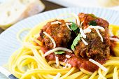 image of cilantro  - Homemade Italian meatballs garnished with cilantro and parmesan cheese over spaghetti for dinner - JPG