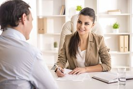 foto of candid  - Businesswoman interviewing male candidate for job in office - JPG