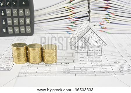 Pile Of Gold Coins And House With Calculator Place Vertical