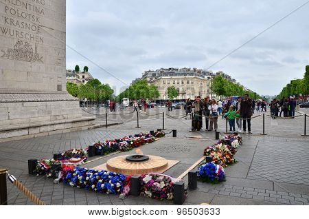 Paris, France - May 14, 2015: Tourist Visit Tomb Of The Unknown Soldier Beneath The Arc De Triomphe