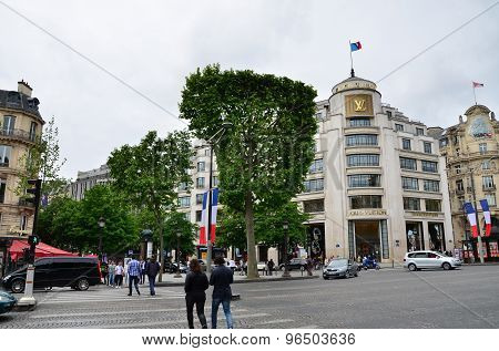 Paris, France - May 14, 2015: Tourists Shopping At Louis Vuitton Store In Paris, France.