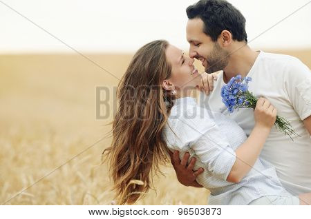 Sensual Young Couple Having Fun Outdoor In Summer Field