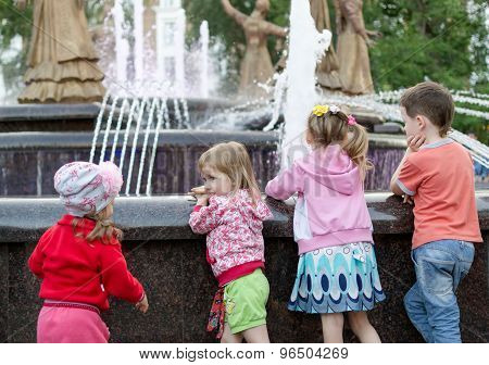 Young Children Watching A Fountain