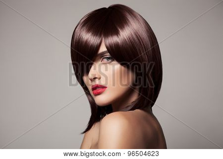 Beauty model with perfect long glossy brown hair. Close-up portrait.