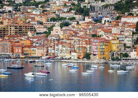 VILLEFRANCHE-SUR-MER, FRANCE - OCTOBER 1, 2014: Colorful waterfront of picturesque French Riviera town with leisure boats anchored in harbor.